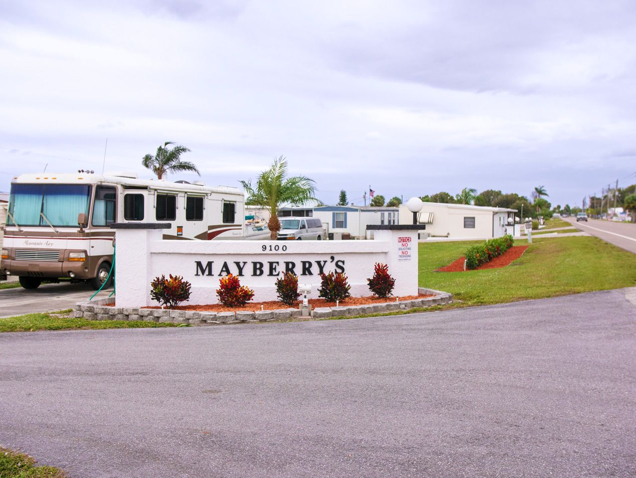 Entrance drive and sign for our Okeechobee, FL Mobile Home & RV Park
