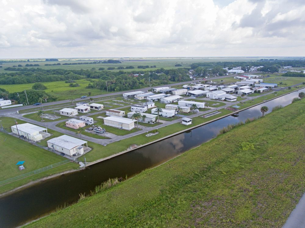 Aerial view of our beautifully-landscaped, spacious Okeechobee, FL RV sites and mobile home lots